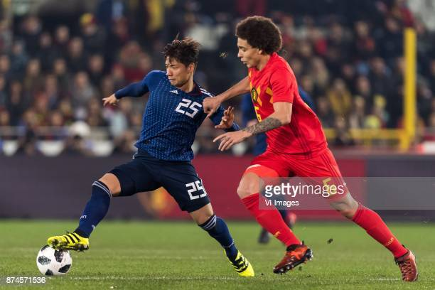 Kazuki Nagasawa of Japan Axel Witsel of Belgium during the friendly match between Belgium and Japan on November 14 2017 at the Jan Breydel stadium in...