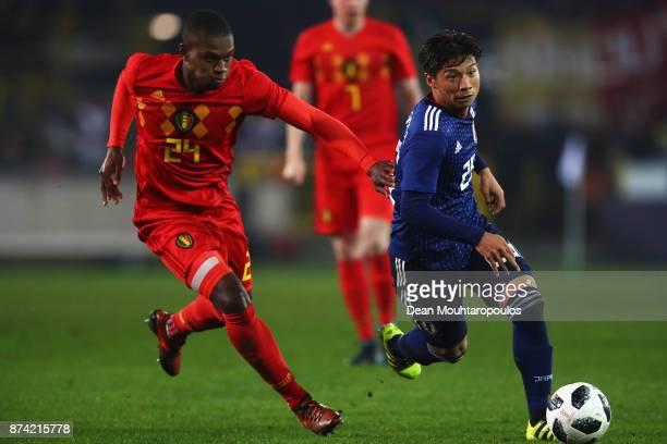Kazuki Nagasawa of Japan battles for the ball with Christian Kabasele of Belgium during the international friendly match between Belgium and Japan...