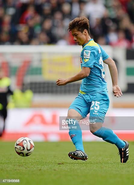 Kazuki Nagasawa of Koeln runs with the ball during the Bundesliga match between FC Augsburg and 1 FC Koeln at SGL Arena on May 2 2015 in Augsburg...