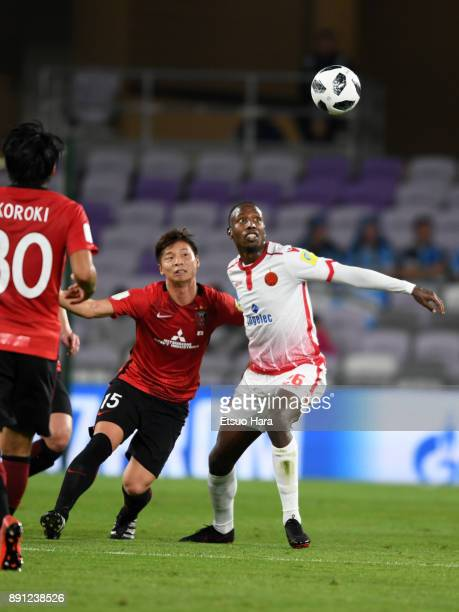 Kazuki Nagasawa of Urawa Red Diamonds and Abdeladim Khadrouf of Wydad Casablanca compete for the ball during the FIFA Club World Cup UAE 2017 Match...