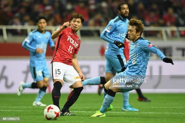 Kazuki Nagasawa of Urawa Red Diamonds and Hiroyuki Abe of Kawasaki Frontale compete for the ball during the JLeague J1 match between Urawa Red...