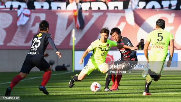 Kazuki Nagasawa of Urawa Red Diamonds and Kento Misao of Kashima Antlers compete for the ball during the JLeague J1 match between Kashima Antlers and...