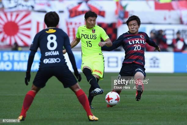 Kazuki Nagasawa of Urawa Red Diamonds and Kento Misao of Kashima Antlers compete for the ball during the J.League J1 match between Kashima Antlers...