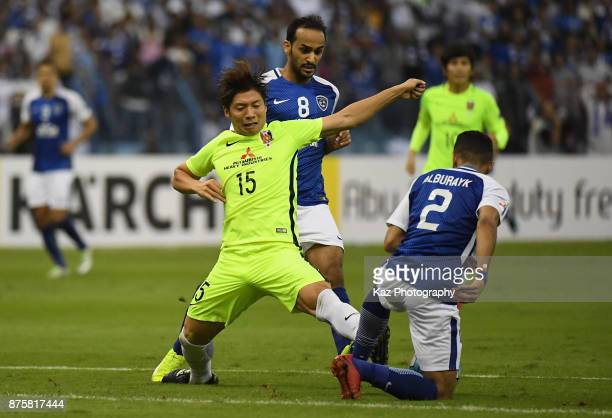 Kazuki Nagasawa of Urawa Red Diamonds and Mohammed AlBurayk of AlHilal compete for the ball during the AFC Champions League Final 2017 first leg...