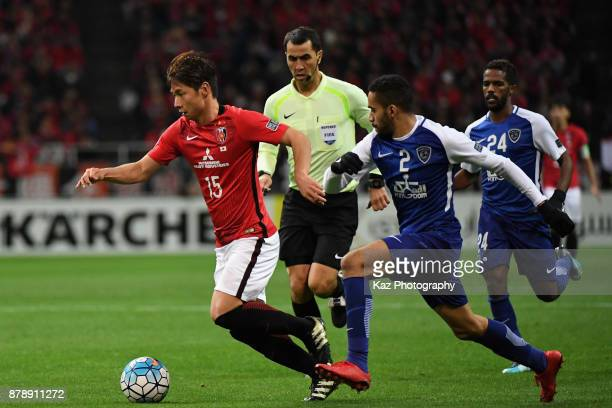 Kazuki Nagasawa of Urawa Red Diamonds and Mohammed AlBurayk of AlHilal compete for the ball during the AFC Champions League Final second leg match...