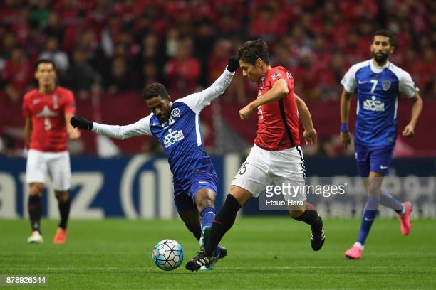 Kazuki Nagasawa of Urawa Red Diamonds and Nawaf Al Abid of AlHilal compete for the ball during the AFC Champions League Final second leg match...