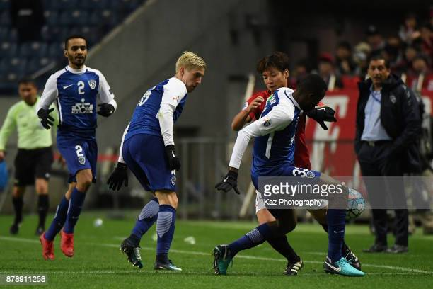 Kazuki Nagasawa of Urawa Red Diamonds and Osama Hawsawi of AlHilal compete for the ball during the AFC Champions League Final second leg match...