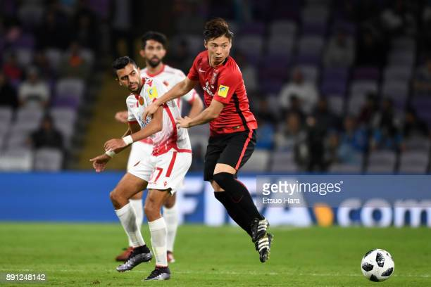 Kazuki Nagasawa of Urawa Red Diamonds and Reda Hajhouj of Wydad Casablanca compete for the ball during the FIFA Club World Cup UAE 2017 Match for 5th...