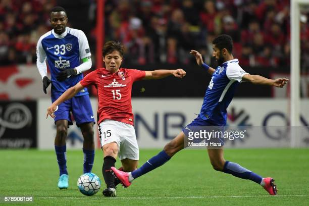 Kazuki Nagasawa of Urawa Red Diamonds and Salman Al Faraj of AlHilal compete for the ball during the AFC Champions League Final second leg match...