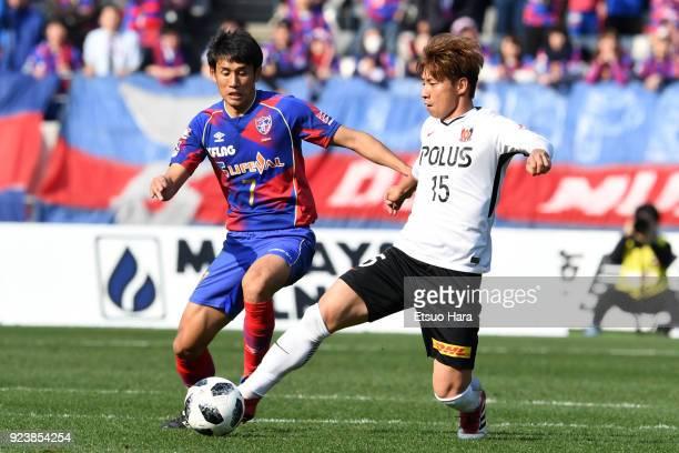 Kazuki Nagasawa of Urawa Red Diamonds and Takuji Yonemoto of FC Tokyo compete for the ball during the JLeague J1 match between FC Tokyo and Urawa Red...