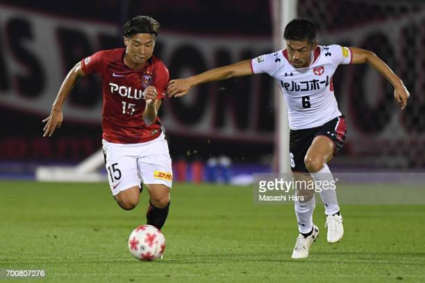 Kazuki Nagasawa of Urawa Red Diamonds and Takuya kakine of Gurlla Morioka compete for the ball during the 97th Emperor's Cup second round match...