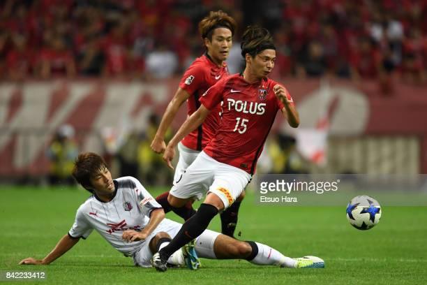 Kazuki Nagasawa of Urawa Red Diamonds and Yasuki Kimoto of Cerezo Osaka compete for the ball during the JLeague Levain Cup quarter final second leg...