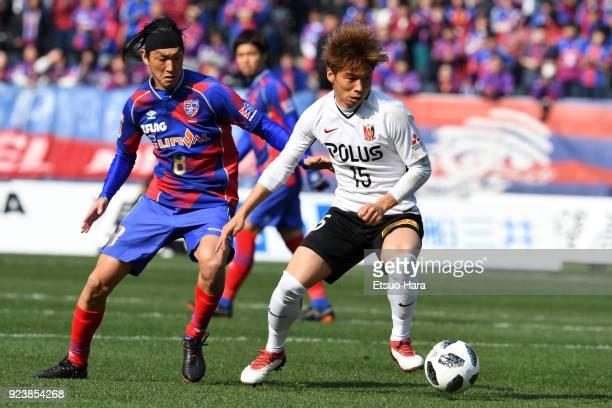 Kazuki Nagasawa of Urawa Red Diamonds and Yojiro Takahagi of FC Tokyo compete for the ball during the JLeague J1 match between FC Tokyo and Urawa Red...