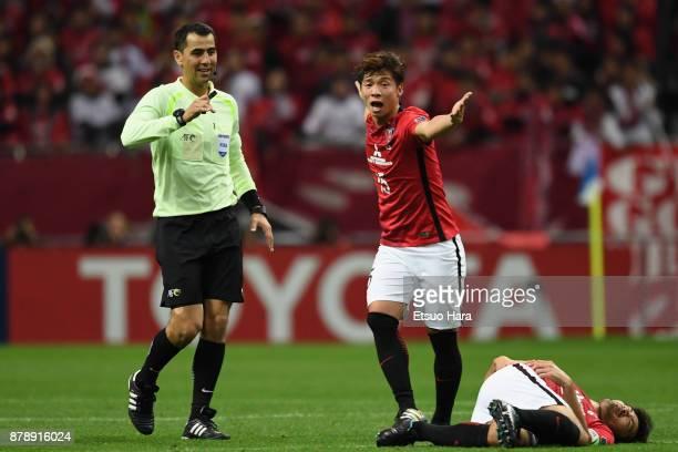 Kazuki Nagasawa of Urawa Red Diamonds appeals to referee Ravshan Irmatov after Yuki Abe of Urawa Red Diamonds is fouled during the AFC Champions...
