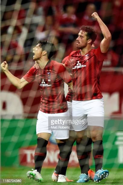 Kazuki Nagasawa of Urawa Red Diamonds celebrates scoring a goal with Maurício Antônio during the AFC Champions League Group G match between Urawa Red...