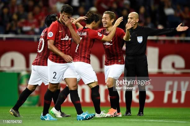 Kazuki Nagasawa of Urawa Red Diamonds celebrates scoring a goal with Ryosuke Yamanaka during the AFC Champions League Group G match between Urawa Red...
