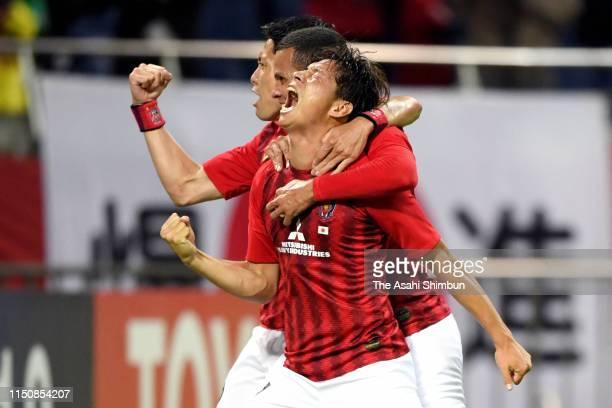 Kazuki Nagasawa of Urawa Red Diamonds celebrates scoring the opening goal with his team mates during the AFC Champions League Group G match between...