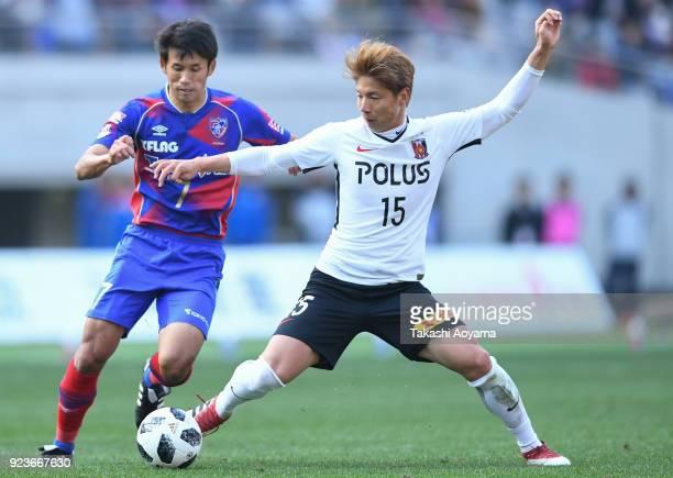 Kazuki Nagasawa of Urawa Red Diamonds compete for the ball against Takuji Yonemoto of FC Tokyo during the JLeague J1 match between FC Tokyo and Urawa...