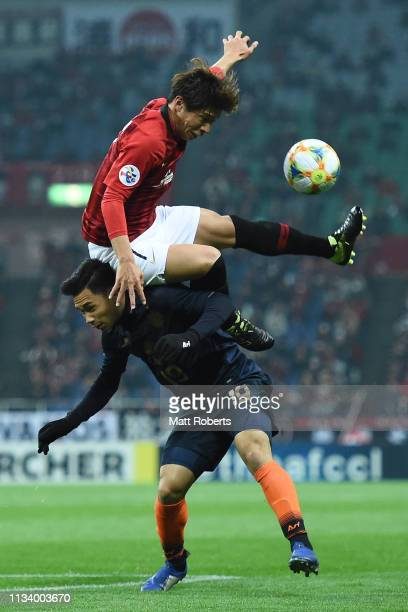 Kazuki Nagasawa of Urawa Red Diamonds competes for the ball against Supachok Sarachart of Buriram United during the AFC Champions League Group G...