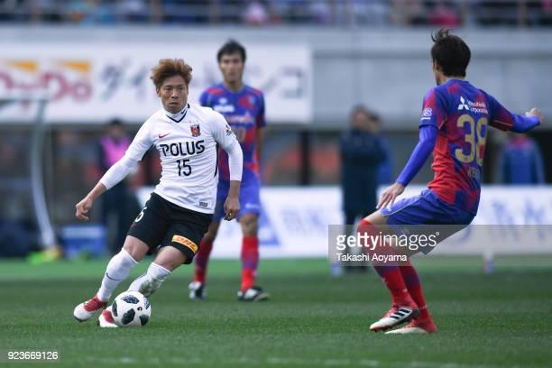 Kazuki Nagasawa of Urawa Red Diamonds controls the ball under pressure of FC Tokyo defense during the JLeague J1 match between FC Tokyo and Urawa Red...