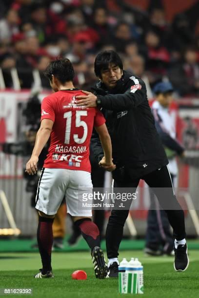 Kazuki Nagasawa of Urawa Red Diamonds is congratulated by head coach Takafumi Hori during the JLeague J1 match between Urawa Red Diamonds and...