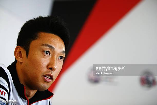 Kazuki Nakajima of Japan and Toyota Gazoo Racing is interviewed at a media session prior to qualifying for the Le Mans 24 Hour race at the Circuit de...