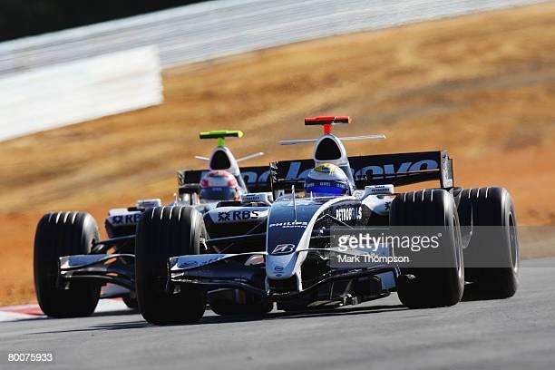 Kazuki Nakajima of Japan and Williams and Nico Rosberg of Germany and Williams in action during preseason Formula One winter testing at the...