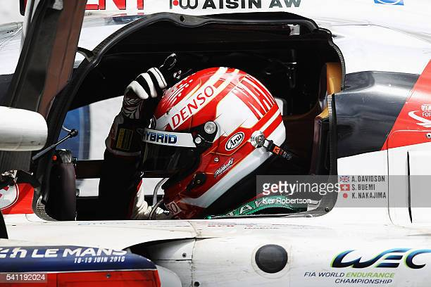 Kazuki Nakajima of Toyota Gazoo Racing reacts in his car after suffering engine problems while leading at the end of the Le Mans 24 Hour race handing...