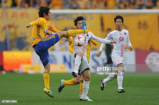 Kazuki Oiwa of Vegalta SAendai nd Yusuke Segawa of Omiya Ardija compete for the ball during the JLeague J1 match between Vegalta Sendai and Omiya...