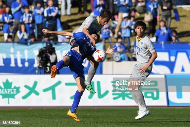 Kazuki Ota of Azul Claro Numazu and Ryosuke Tada of Tochigi SC compete for the ball during the JLeague J3 match between Azul Claro Numazu and Tochigi...