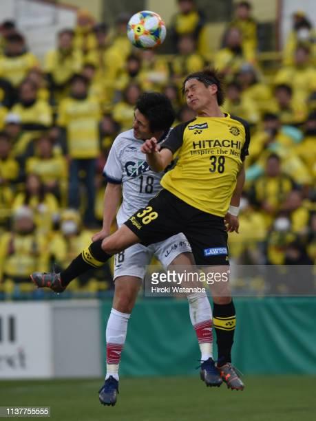 Kazuki Saito of Fagiano Okayama and Daisuke Kikuchi of Kashiwa Reysol compete for the ball during the J.League J2 match between Kashiwa Reysol and...