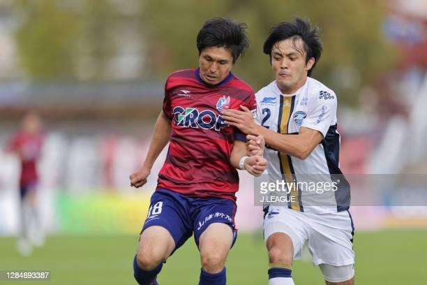 Kazuki SAITO of Fagiano Okayama and Masayuki OKUYAMA of Machida Zelvia battle for the ball during the J.League Meiji Yasuda J2 match between Fagiano...