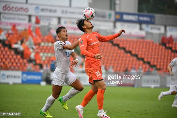 Kazuki SEGAWA of Tochigi SC and Takamitsu TOMIYAMA of Omiya Ardija battle for the ball during the J.League Meiji Yasuda J2 match between Omiya Ardija...