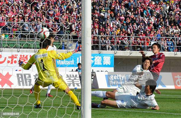 Kazuki Someya of Fagiano Okayama scores his team's third goal past Yoshikatsu Kawaguchi of FC Gifu during the JLeague second division match between...