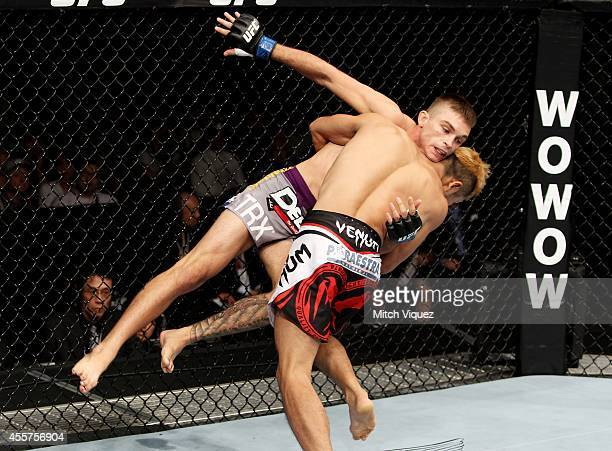 Kazuki Tokudome goes for a takedown on Johnny Case in their lightweight bout during the UFC Fight Night event inside the Saitama Arena on September...