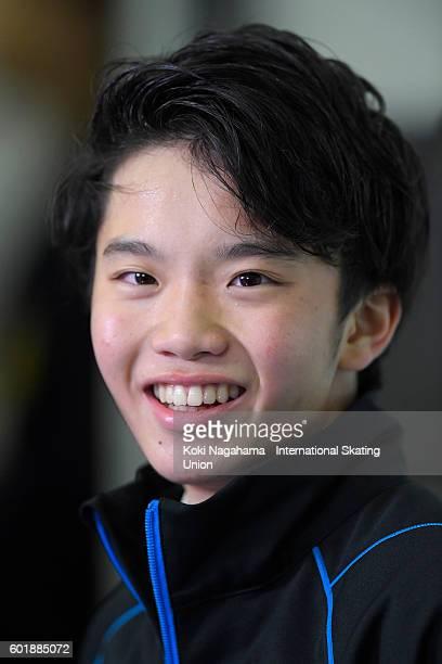 Kazuki Tomono of Japan looks on at the kiss and cry after the men's free program during the ISU Junior Grand Prix of Figure Skating Yokohama on...