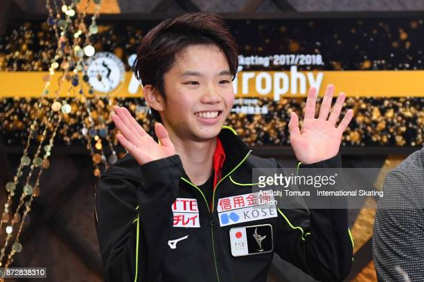 Kazuki Tomono of Japan smiles after competing at the kiss and cry during the ISU Grand Prix of Figure Skating at on November 11 2017 in Osaka Japan