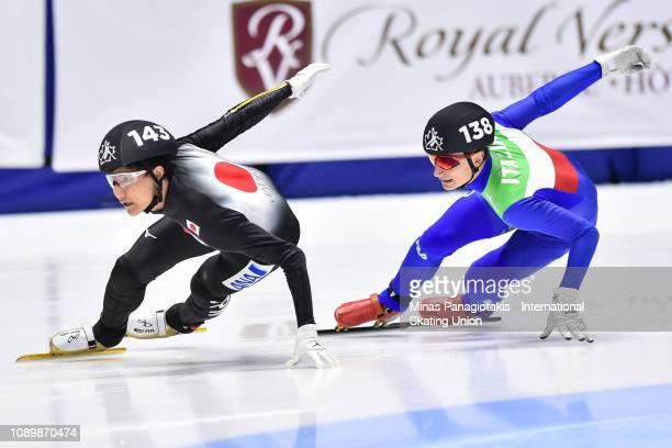 Kazuki Yoshinaga of Japan competes against Pietro Sighel of Italy in the men's 500 meter quarterfinal during the ISU World Junior Short Track...