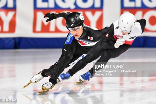 Kazuki Yoshinaga of Japan competes in the men's 1000 meter Ranking Final during the World Short Track Speed Skating Championships at Maurice Richard...