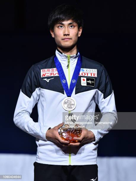 Kazuki Yoshinaga of Japan stand on the podium with his bronze medal after finishing third in the men's 1000m final during the ISU World Junior Short...