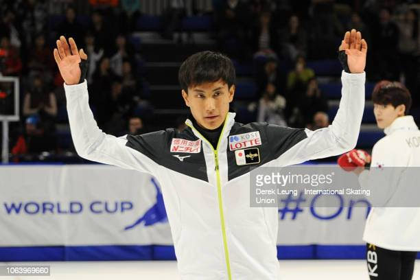 Kazuki Yoshinaga of Japan waves to the crowd after placing first in the 1500m men's final during the ISU World Cup Short Track Calgary at the Olympic...