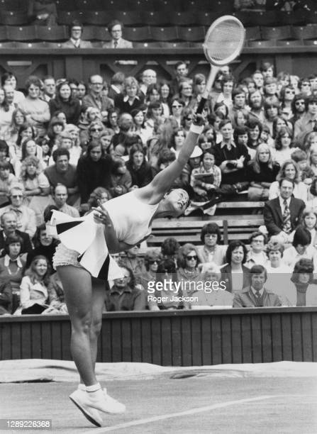 Kazuko Sawamatsu of Japan serves to Julie Heldman of the United States during their Women's Singles Second Round match at the Wimbledon Lawn Tennis...