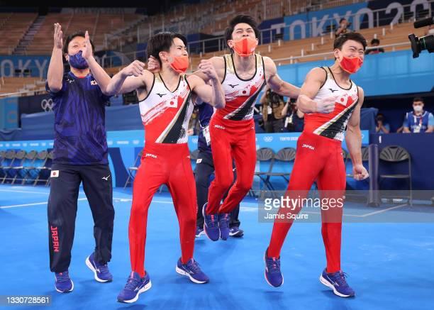 Kazuma Kaya, Wataru Tanigawa and Takeru Kitazono of Team Japan react after winning the silver medal in the Men's Team Final on day three of the Tokyo...