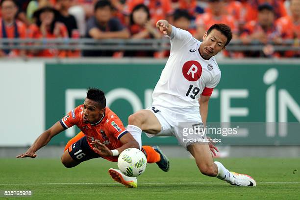 Kazuma Watanabe of Vissel Kobe and Mateus of Vissel Kobe compete for the ball during the JLeague match between Omiya and Vissel Kobe at the Nack 5...