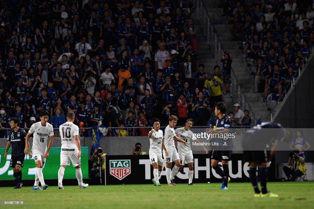 Kazuma Watanabe (3rd R) of Vissel Kobe celebrates scoring the opening goal with hsi team mates during the J.League J1 match between Gamba Osaka and Vissel Kobe at Suita City Football Stadium on September 9, 2017 in Suita, Osaka, Japan.