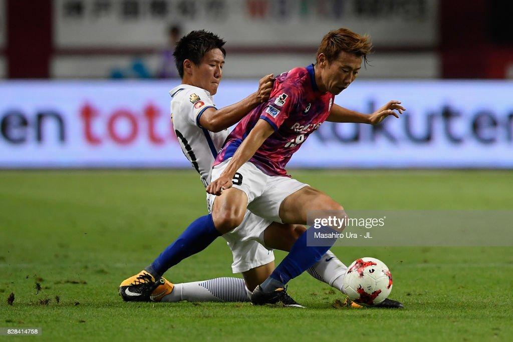 Kazuma Watanabe of Vissel Kobe is tackled by Kento Misao of Kashima Antlers during the J.League J1 match between Vissel Kobe and Kashima Antlers at Noevir Stadium Kobe on August 9, 2017 in Kobe, Hyogo, Japan.