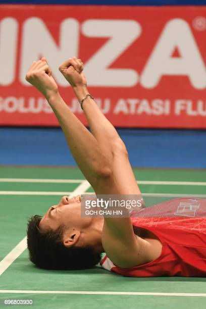 Kazumasa Sakai of Japan celebrates after beating Prannoy HS of India in the men's singles semifinal match at the Indonesia Open badminton tournament...