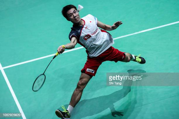 Kazumasa Sakai of Japan competes in the Men's Singles first round match against Lin Dan of China on day two of the French Open at Stade Pierre de...