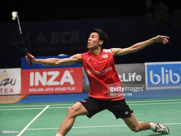 Kazumasa Sakai of Japan returns a shot against Prannoy HS of India in the men's singles semifinal match at the Indonesia Open badminton tournament in...