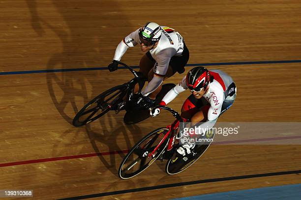 Kazunari Watanabe of Japan and Robert Forstemann of Germany compete in the Men's Sprint Quarter Finals during the UCI Track Cycling World Cup - LOCOG...